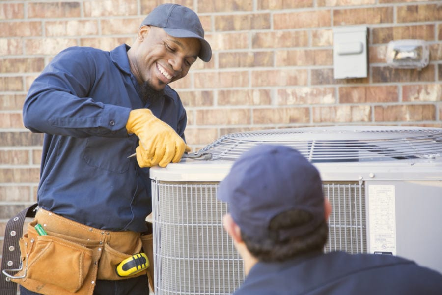 Air conditioner technicians working on ac repair.