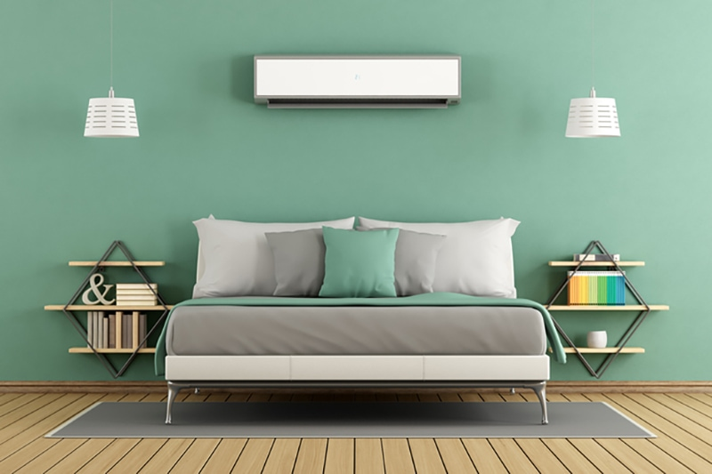 Green modern living room with ductless unit